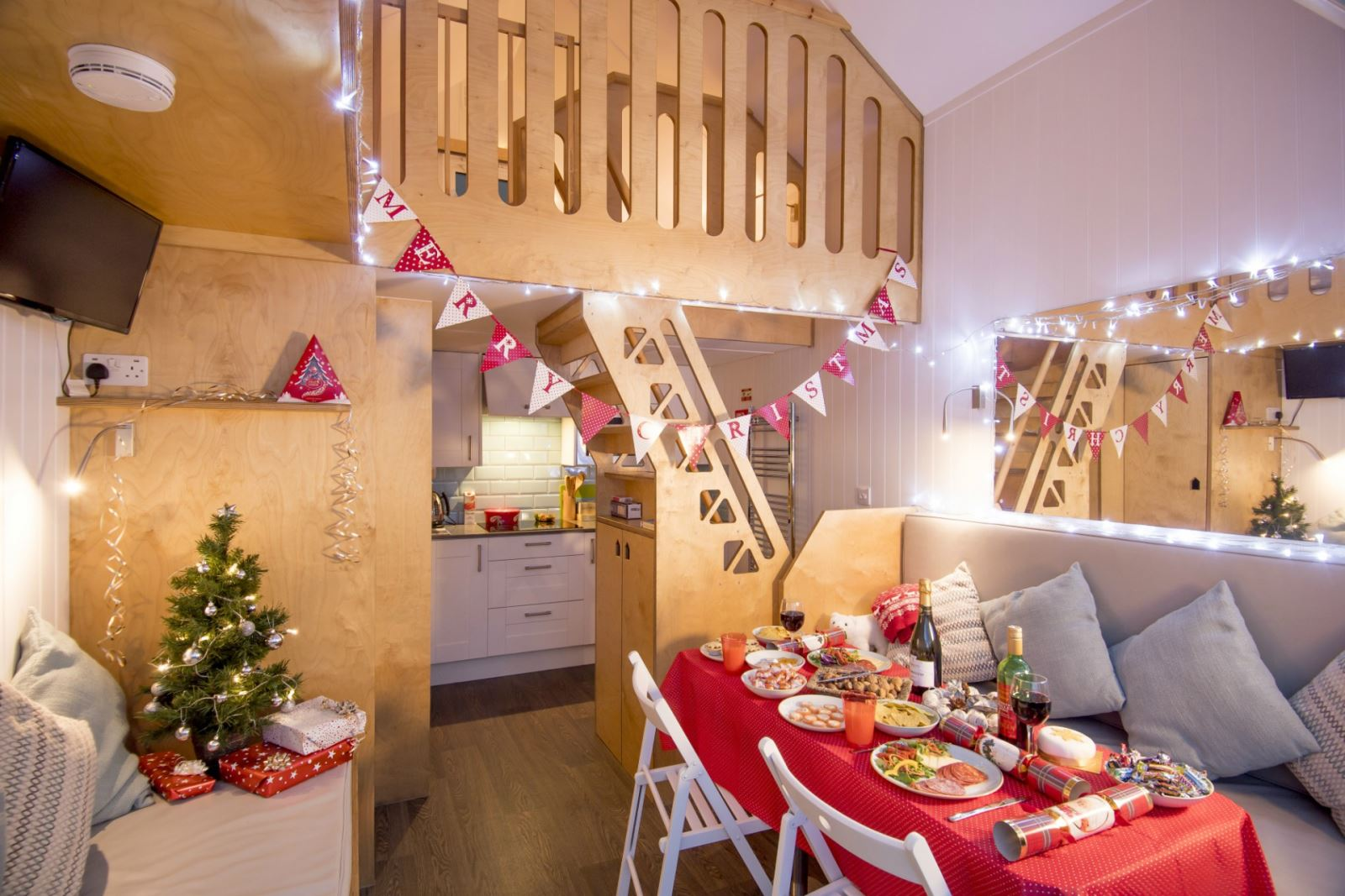 A view inside the Bournemouth beach lodges, with the interior bedecked in Christmas decorations and a table laid for a traditional Christmas dinner
