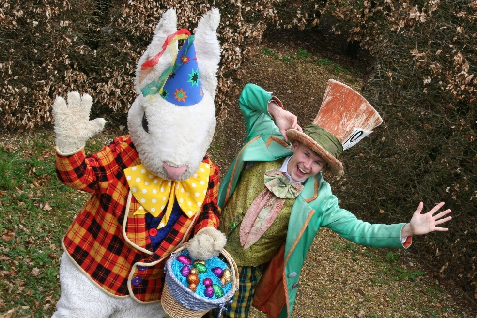 Rabbit and the mad hatter enjoying their Easter egg hut at Adventure wonderland