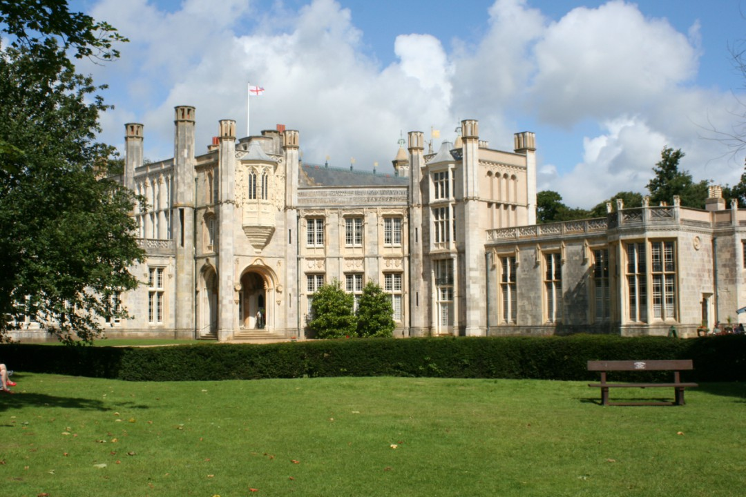 Highcliffe Castle in Christchurch on a warm afternoon with a blue, cloudy sky overhead