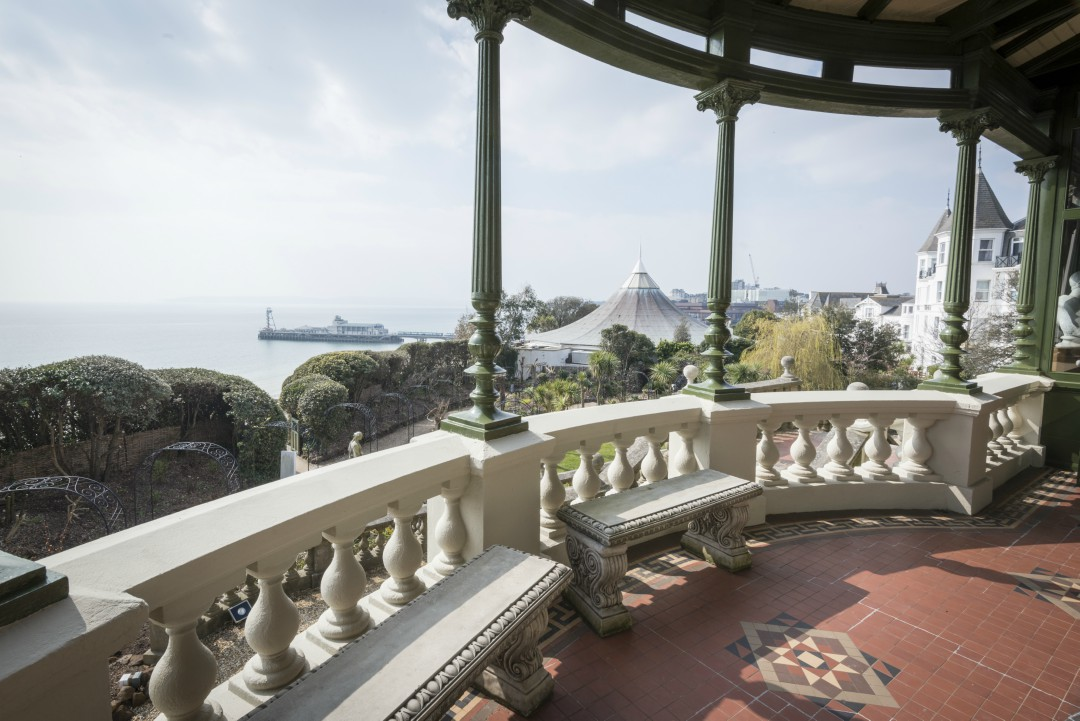 A view from a terrace at the Russell-Cotes museum towards Bournemouth Pier with a clear view of the ocean.