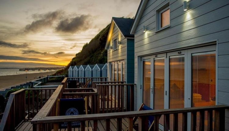 Sunset over the Bournemouth beach lodges in Boscombe