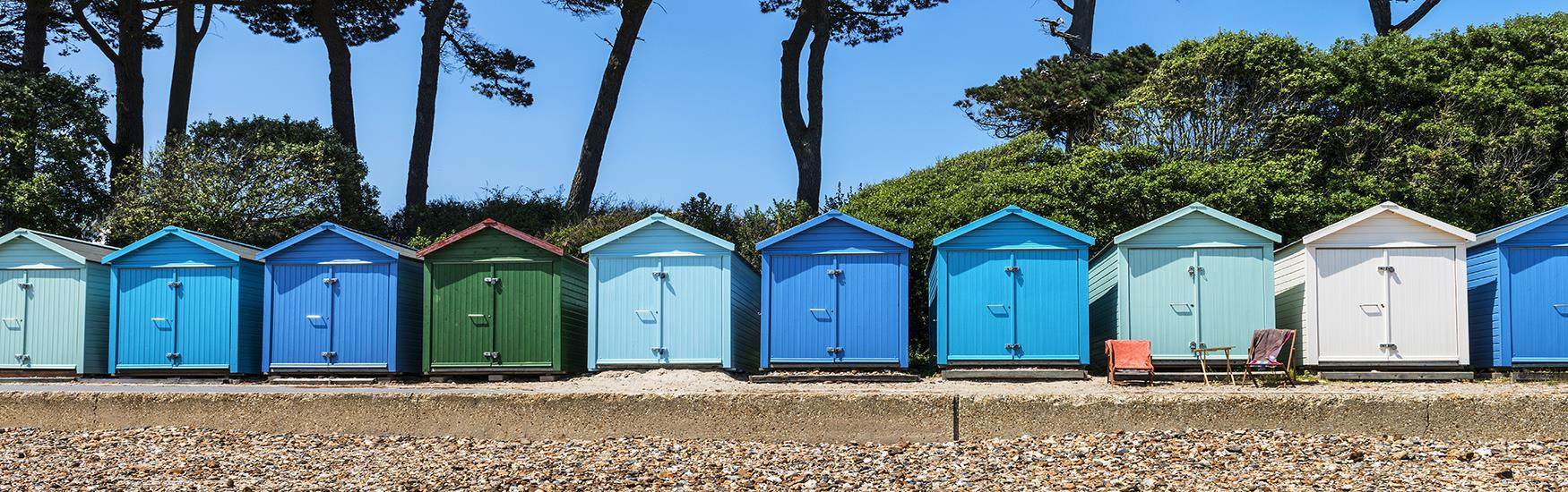 A colourful array of immaculate looking beach huts found in Christchurch