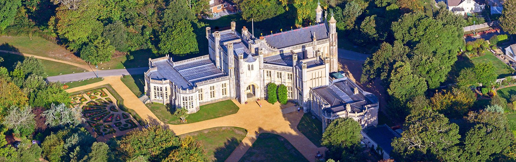 Stunning aerial shot of Highcliffe castle illuminated by the warm sun