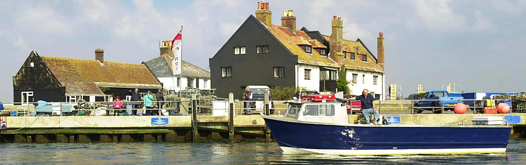 Mudeford Ferry moored alongside the quay