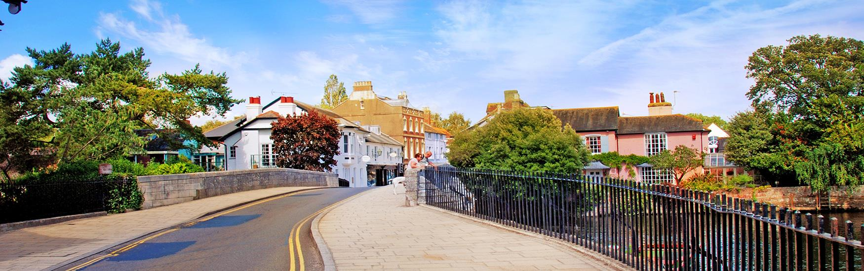 Lovely shot of a Christchurch road over the bridge leading into the town on a sunny day