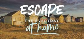 Mudeford beach huts at dusk with the text Escape the Everyday at home