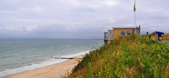 View of Southbourne beach with golden sand and green cliff tops