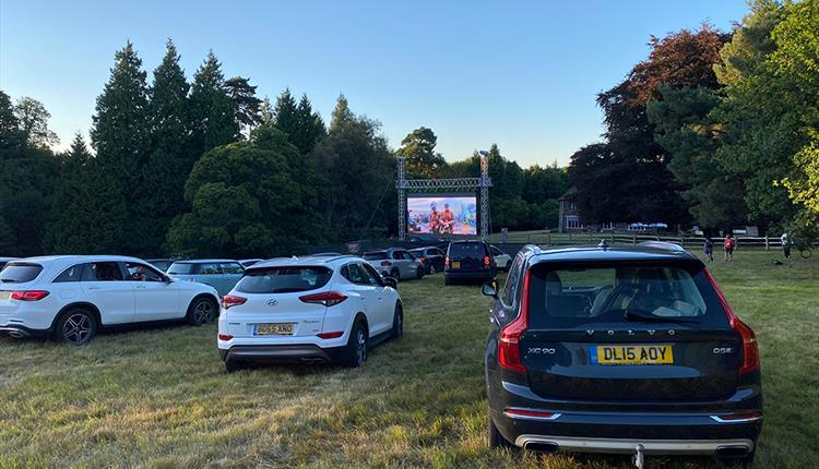 Row or cars outdoor watching a cinema screen