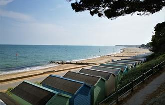 Friars Cliff Beach Huts view west towards Mudeford and Bournemouth.