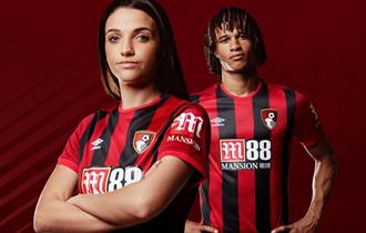 Bournemouth female and male football players posing in their Bournemouth shirts for the camera