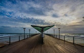 Moody skies over Boscombe pier in Bournemouth