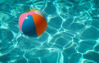 Inflatable ball floating in clear water.