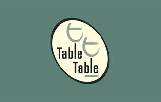 table table logo on green background.