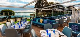 Credit Christchurch Harbour Hotel & Spa  | Hotel ready for guests to drink and dine outside with amazing scenery of mudeford |