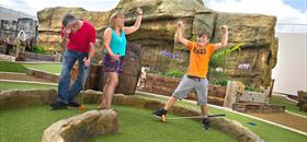 Family celebrating their adventure golf fun at Smugglers cove