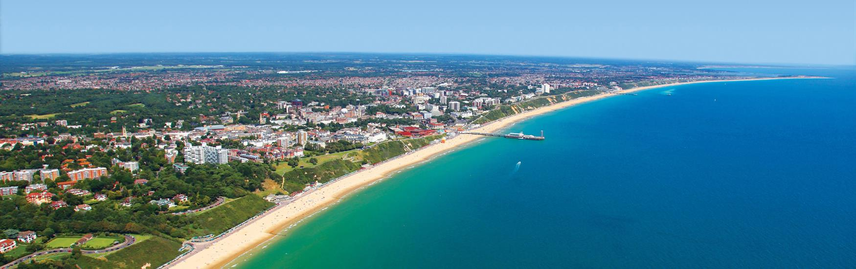 Sweeping shot of Bournemouth from the Air Turquoise Sea Bay