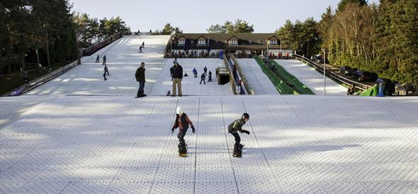 Children Snowboarding Practice at Snowtrax Ski Slopes Matchams Bournemouth