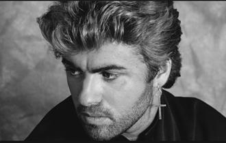 Black and white photo of George Michael