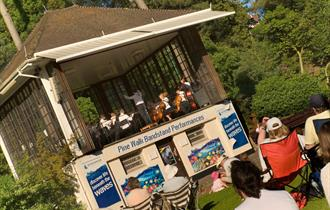 Bandstand in Lower Gardens Bournemouth with band playing