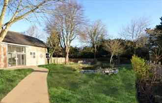 a photo of Kingfisher Barn Visitor Centre on a bright sunny day