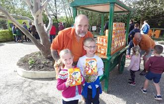 Monkey World Animal Director Jeremy Keeling with two children and Easter Eggs at the park