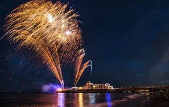 Beautiful colourful fireworks in the dark along the coast. Image subject to copyright