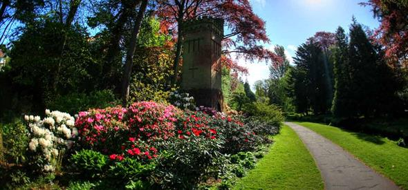 Folly tower surrounded by flora in the gardens