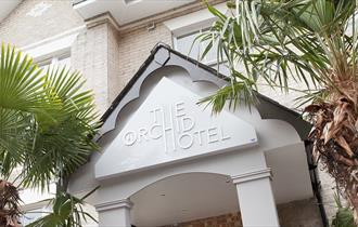 The exterior of the Orchid Hotel