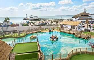 Overhead shot of the stunning smugglers crazy golf with Bournemouth beach and pier in the background