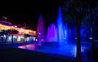 Pavilion Theatre Night Time Shot with Fountain