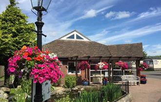 reception on a beautiful bright day with flowering hanging baskets