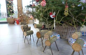 Reindeer Making, photo of handmade log reindeers