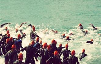 Swimmers make a mad dash into the sea to start the race