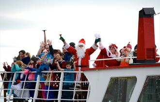 Santa and friends on his Poole themed sleigh (a boat)