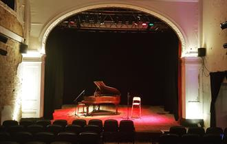 Picture of Shelley Theatre inside with piano on stage