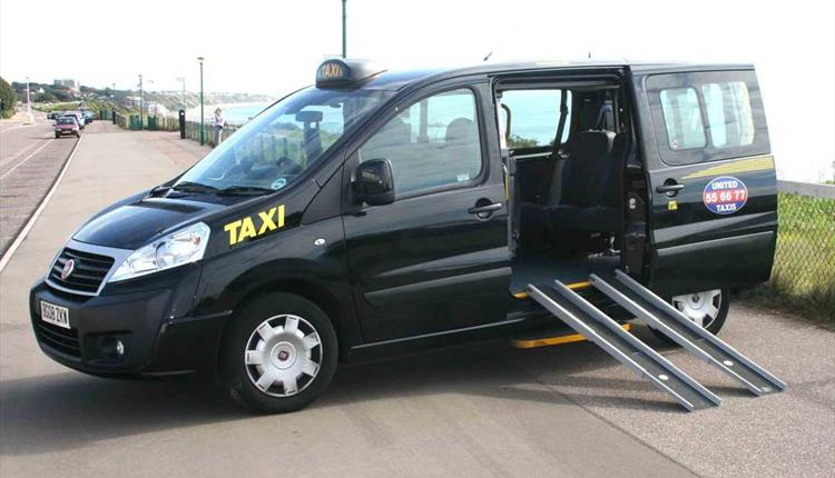 Black disabled friendly taxi parked on Bournemouth overcliff