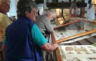 Group of people looking around museum