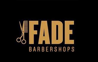 fade barbershops gold logo on black background