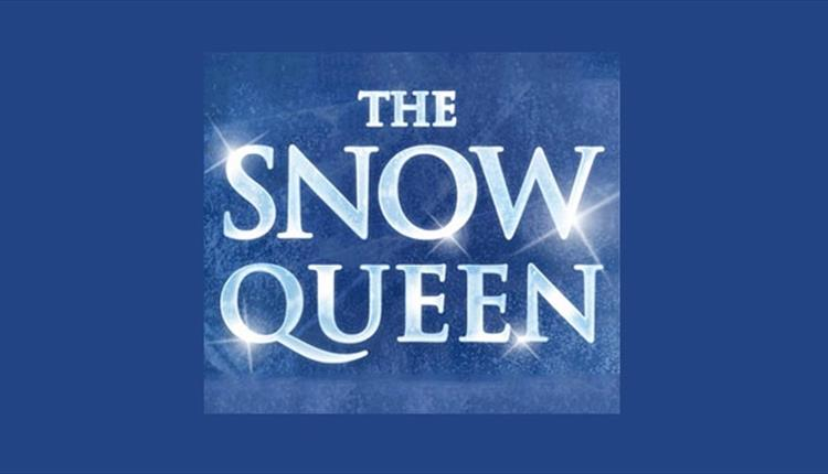 the snow queen icy text sparkling on a blue background.